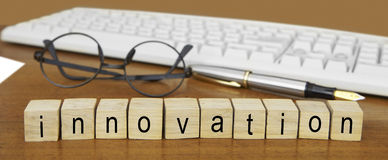 The word innovation on wood stamp Stock Photos