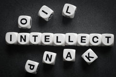Word intellect on toy cubes. Word intellect on white toy cubes stock photography