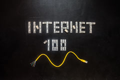 Word 'Internet' and numeral '100', made of connectors RJ45 stock images