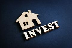 Free Word Invest And Model Of Home. Real Estate Investment Concept Stock Images - 160436214