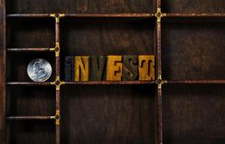 Word invest with silver coin in box Royalty Free Stock Photos