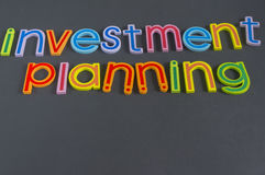 Word of Investment Planning. Composed on blackboard - Investment Concept Royalty Free Stock Image