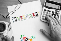 Word investment on white page Royalty Free Stock Image