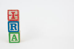 The Word IRA in Wooden Childrens Blocks stock photos