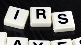 The Word IRS Taxes  - A Term Used For Business in Finance and Stock Market Trading stock video