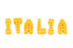 Word Italia written with pasta. Shapes on white Stock Photography