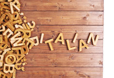 Word italian made with wooden letters Stock Photos