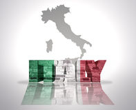 Word Italy  on a map background. Word Italy with National Flag near map of Italy Royalty Free Stock Images