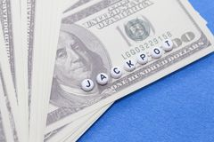 Word `JACKPOT` with poker chips and money Royalty Free Stock Images