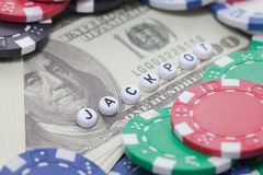 Word `JACKPOT` with poker chips and money Royalty Free Stock Photo