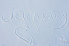 The word January written on snow background Royalty Free Stock Images