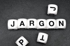 Word jargon on toy cubes Stock Images