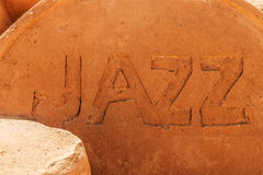 The word Jazz photographed in sand Stock Photography