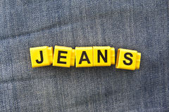 Word - jeans - made ​​up of cubes Stock Images