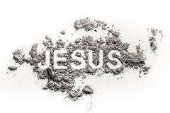 Word Jesus written in ash. Sand or dust as son of god, the messiah, savior or redeemer concept, founder of christian religion Stock Image