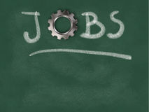 The word jobs with gear wheel on chalkboard Royalty Free Stock Photography