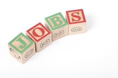 The word `JOBS` spelt out with Children`s building blocks Stock Photo
