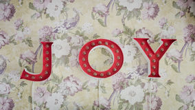 Word Joy hang on wallpaper Stock Images
