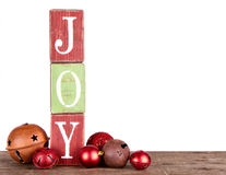The word joy spelled out on blocks. Isolated on white, Christmas ornaments Royalty Free Stock Photography