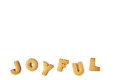 The word JOYFUL spelled with alphabet shaped biscuits, isolated on white background with free space for text stock image