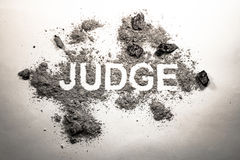 Word judge written in dirt, filth, ash, grime, dust as justice, Stock Photo