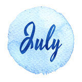 Word July on blue watercolor background. Sticker, label, round shape Royalty Free Stock Photo
