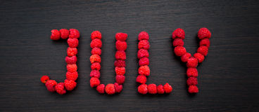 Word July of raspberries Royalty Free Stock Image
