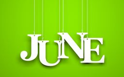 Word JUNE hanging on the ropes. Green background with hanging letters which make up the word - JUNE Royalty Free Stock Photos