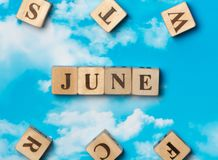 The word June. On the sky background Stock Photo