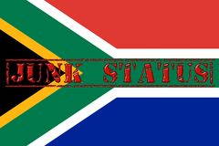 Word Junk Status stamped across the South African Flag Stock Images