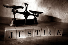 The Word Justice in Letter Blocks and Law Scale Royalty Free Stock Photos