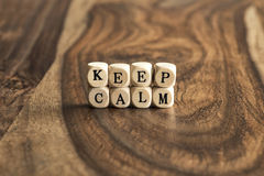 Word KEEP CALM on wooden cubes Royalty Free Stock Photo
