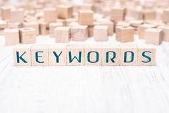 The Word Keywords Formed By Wooden Blocks On A White Table. The Word Keywords Formed By Wooden Blocks On White Table stock image