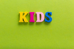 Word kids of English color wooden letters of the alphabet Stock Photo