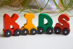 Word kids made of letters train alphabet. Bright colors of red yellow green and blue on a white background. Early childhood develo. Pment, learning to read and stock images