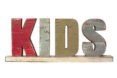 Word Kids Spelled in Wooden Letters. The word kids spelled in weathered rough wooden letters, isolated on white stock photos