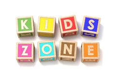 Word KIDS ZONE made of wooden blocks toy 3D. Render illustration isolated on white background Stock Photo