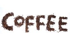 Word koffie met koffiebonen die wordt geschreven Stock Foto