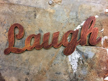 Word laugh background. A brown word laugh background Stock Photos