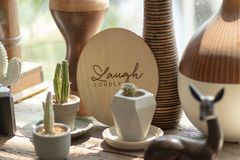 The word LAUGH LOUDLY was printed on circular wooden background stock images