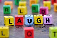 The word Laugh on table. The word Laugh on wooden table Royalty Free Stock Image