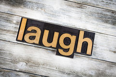 Laugh Letterpress Word on Wooden Background Royalty Free Stock Images