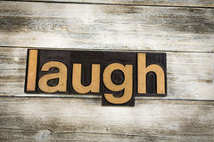 Laugh Letterpress Word on Wooden Background Royalty Free Stock Photography