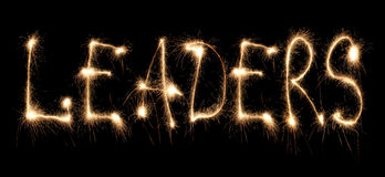 Word leaders written sparkler. On dark stock photo