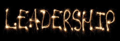 Word leadership written sparkler Stock Images