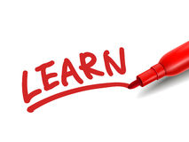 The word learn with a red marker. Over white Royalty Free Stock Photography