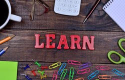 The word Learn on table. The word Learn on wooden table Stock Image