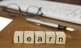 The word learn on wood stamp Stock Photography