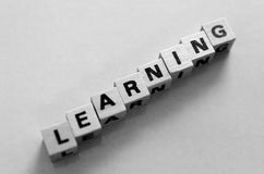The word learning written in cubes. Black and white stock photo