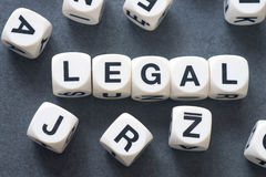 Word legal on toy cubes. Word legal on white toy cubes Royalty Free Stock Photography
